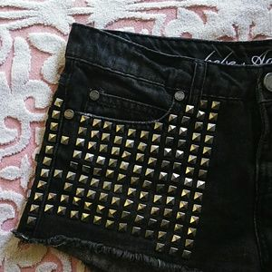 Bebe cut off studded shorts they are insane!!